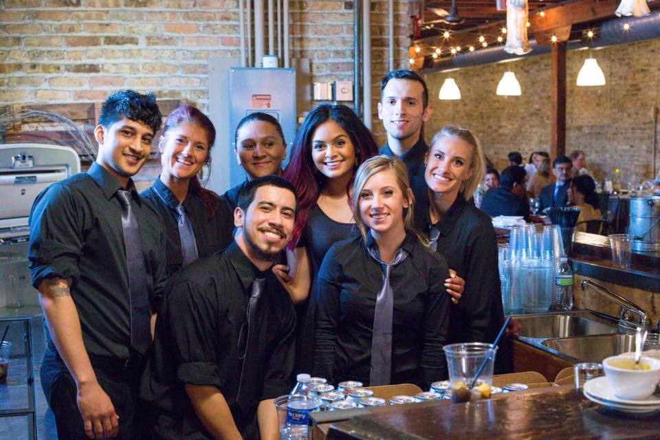 friendly servers and bartenders preparing for an event
