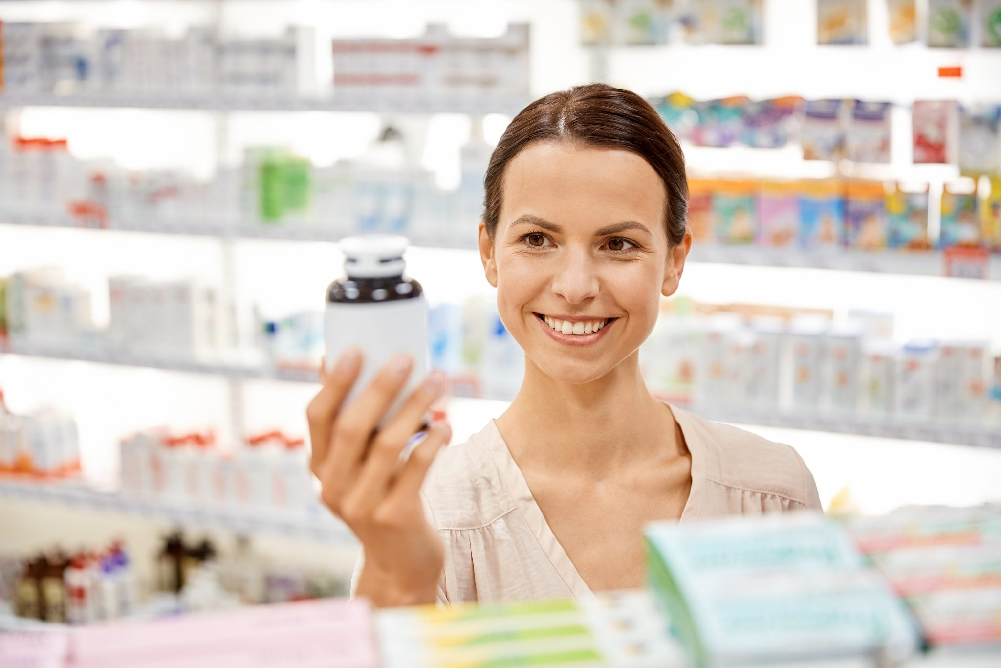 Pharmaceutical sales representative holding up a bottle of pills