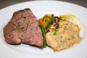 surf and turf plate with prime rib and lobster